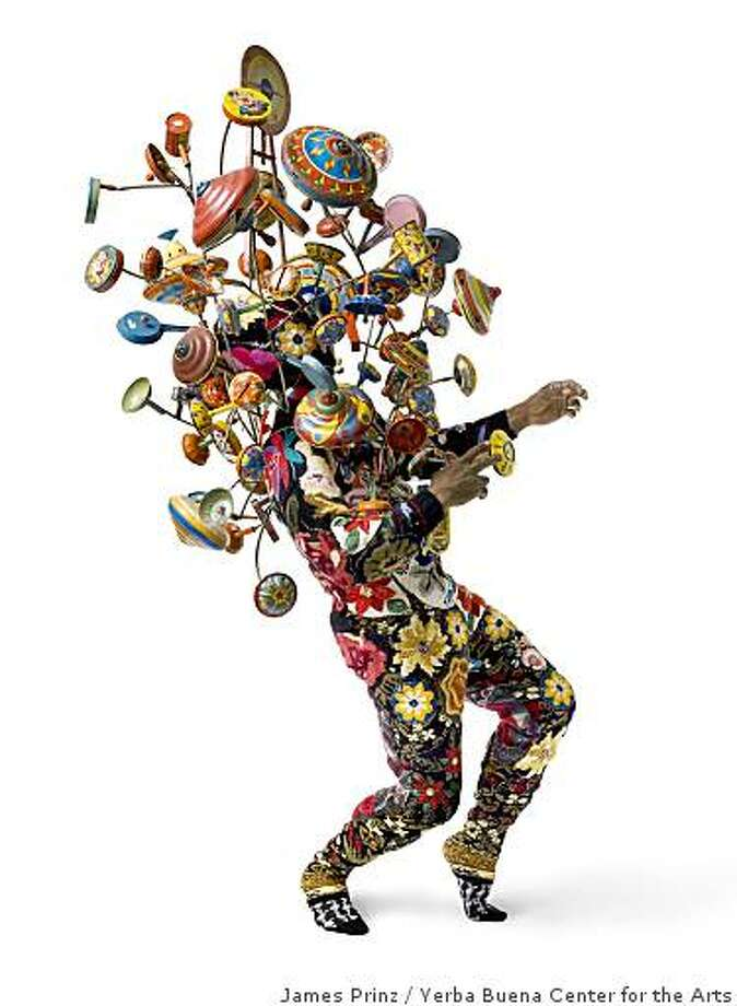 """Soundsuit"" (2008) appliqued found knitted and crocheted fabric, metal armature, painted metal and wooden toys by Nick Cave98"" x 38"" x 34"" Photo: James Prinz, Yerba Buena Center For The Arts"