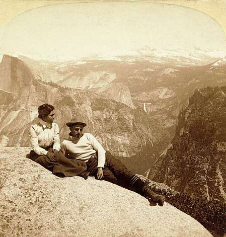 "Tourists overlooking Yosemite Valley, circa 1902. A man and woman lounge on Eagle Rock in Yosemite National Park.  Half Dome and Nevada Falls are in the background. ""The National Parks: America's Best Idea:"" is a six-part, 12-hour film by Ken Burns on the history of AmericaÕs national parks and the people who were willing to devote themselves to saving some precious portion of the land they loved. Photo: Library Of Congress"