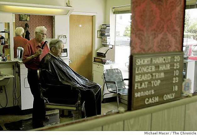 Barber, Vince Mantia at his shop on Main Street with client, Bob Cardoni, on Tuesday Mar. 3, 2009, in the City of Half Moon Bay, Calif. The City plans to use the Federal Stimulus money it will receive to resurface 5 blocks of it's Main Street that run through the center of town. Photo: Michael Macor, The Chronicle