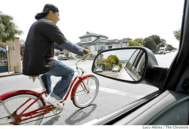 Residents walk and ride their bikes to get around Half Moon Bay as tourist drive to see the sights, Monday April 13, 2009, in Half Moon Bay, Calif.Calif. Photo: Lacy Atkins, The Chronicle