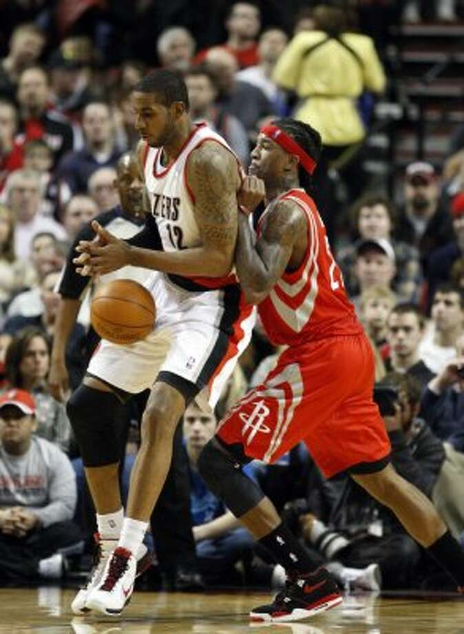 Feb. 8: Rockets 103, Trail Blazers 96 Portland's LaMarcus Aldridge, left, loses the ball while under pressure from Jordan Hill during the second quarter of Wednesday night's game in Portland, Ore. (Rick Bowmer / Associated Press)