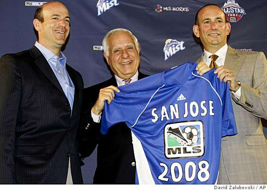 Don Garber, right, commissioner of Major League Soccer, joins the new owners of the San Jose Earthquakes, Lew Wolff, center, and John fisher, left, in holding up a jersey for the expansion team during a news conference in the northeast Denver suburb of Commerce City, Colo., on Wednesday, July 18, 2007. Garber announced that the league will give a franchise to San Jose for the 2008 season and plans are in the works for two more expansion franchises by 2010. (AP Photo/David Zalubowski) Photo: David Zalubowski, AP
