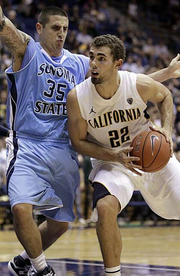 California's Harper Kamp, right, drives against Sonoma State's James Sandoval (35) during the second half of an exhibition NCAA college basketball game Wednesday, Nov. 10, 2010, in Berkeley, Calif. Photo: Ben Margot, AP
