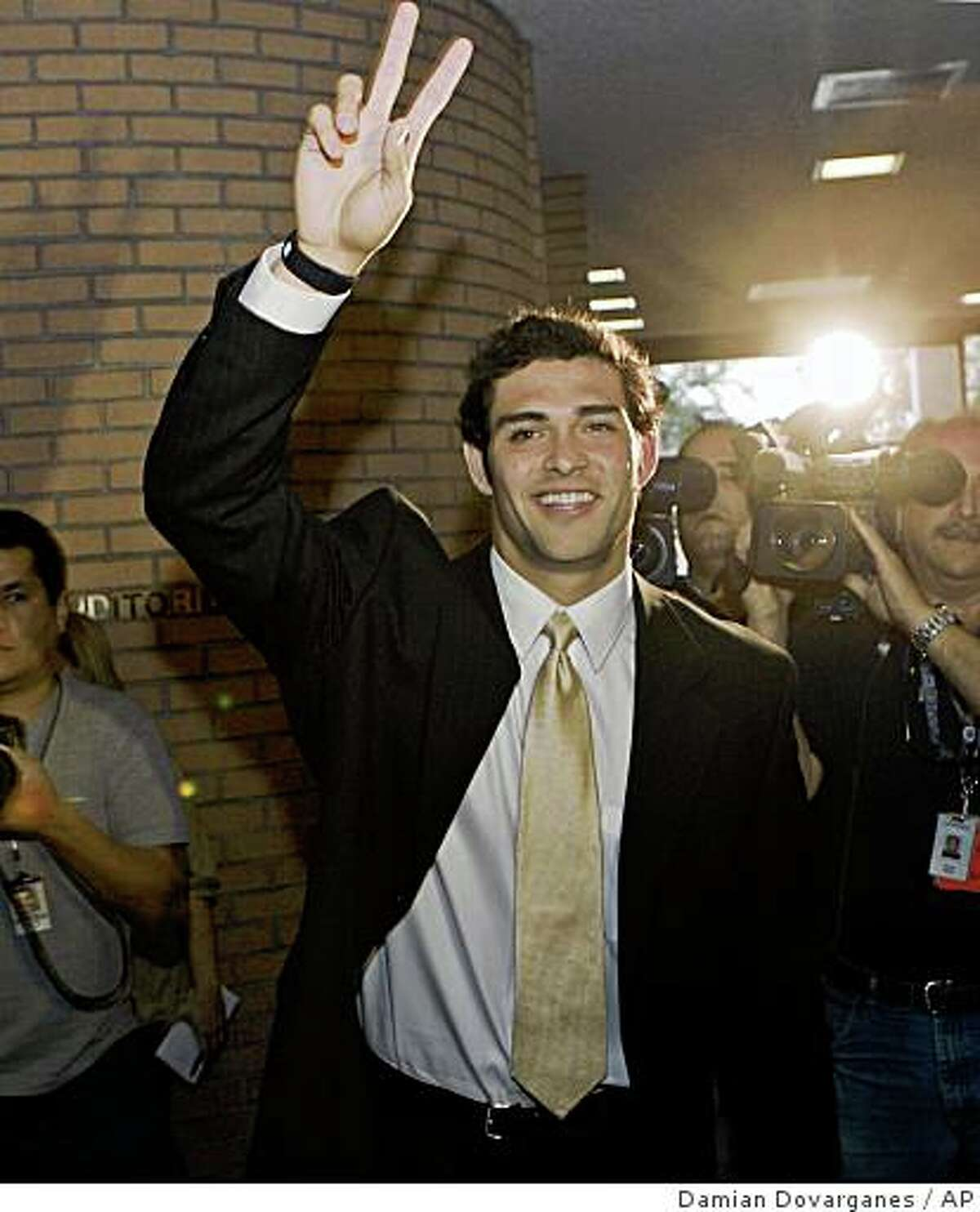 Southern California quarterback Mark Sanchez waves to fans after announcing that he would make himself available for the NFL draft at a news conference at the USC campus in Los Angeles on Thursday, Jan. 15, 2009. (AP Photo/Damian Dovarganes)