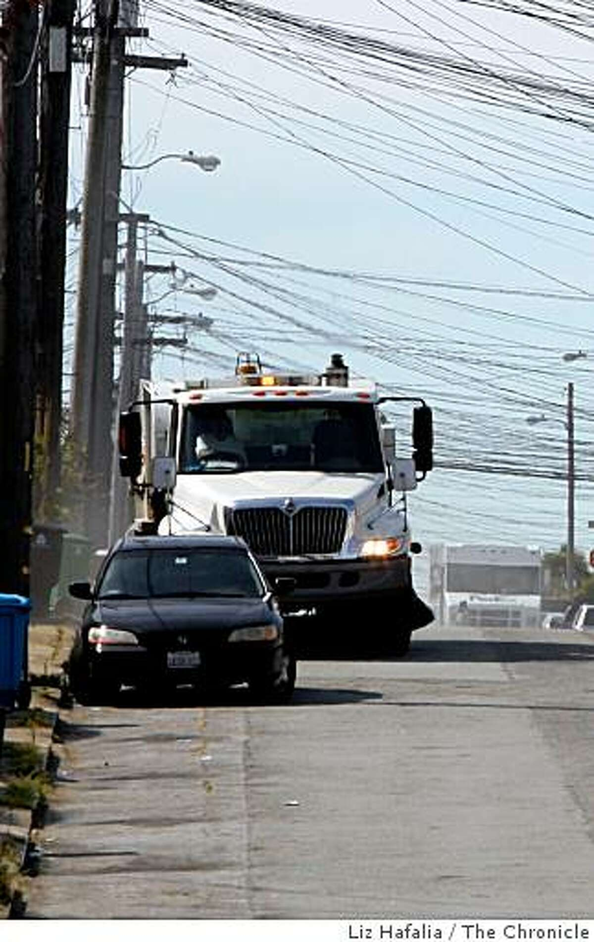 Parking ticket revenue dropped 26 percent last fall when there was a cut in street sweeping last year. Streetsweeper passes a ticketed vehicle on 35th Ave. near Lincoln Blvd. in San Francisco, Calif., on Tuesday, April 21, 2009.