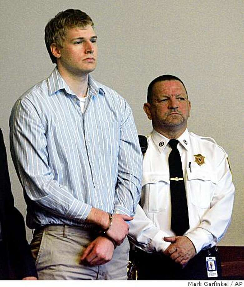 Boston University medical student Philip Markoff stands during his arraignment in Boston Municipal Court, Tuesday, April 21, 2009, in Boston. Markoff has been ordered held without bail on charges that he fatally shot a masseuse he had lured to his hotel through Craigslist. Photo: Mark Garfinkel, AP