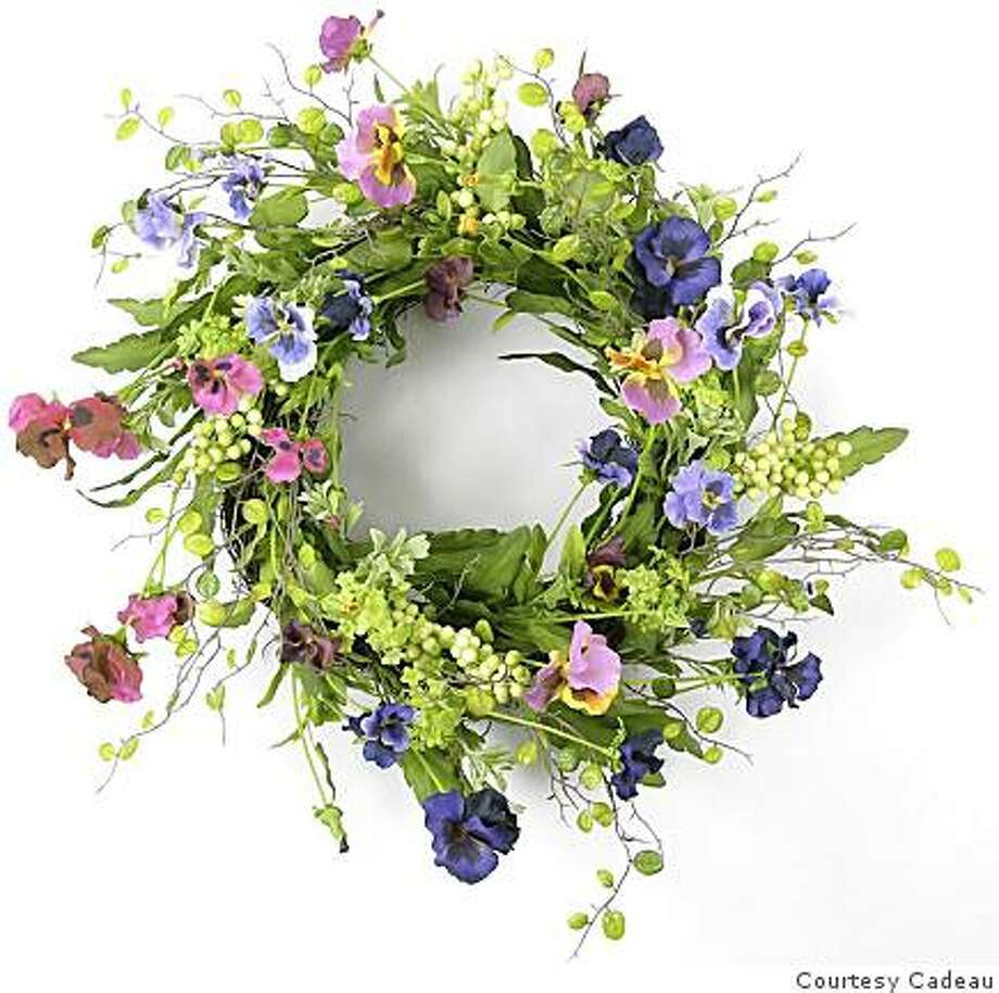 A pansy wreath, made of permanent botanical products, is an example of products for sale at the warehouse sale at Cadeau. Photo: Courtesy Cadeau