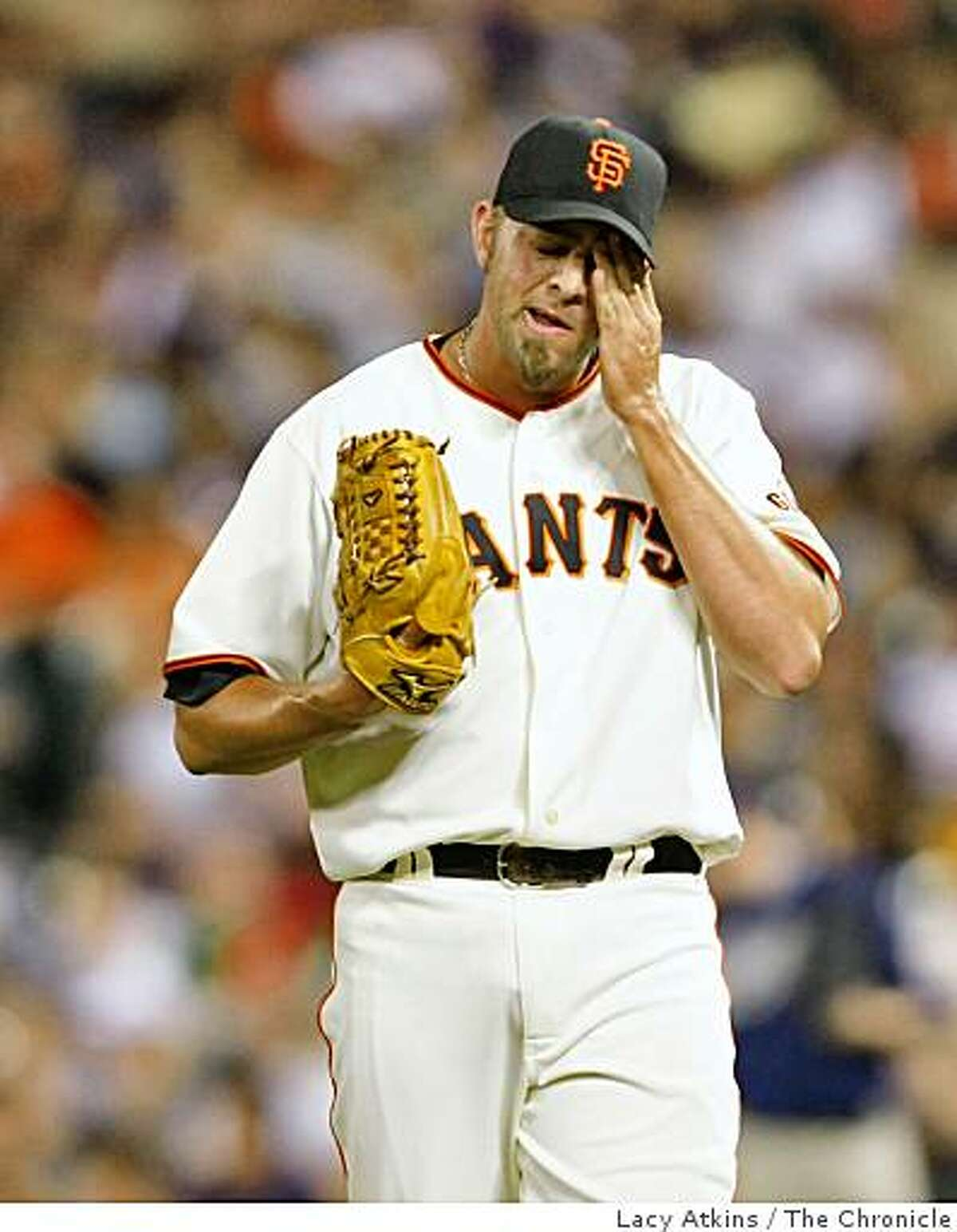 Giants pitcher Jeremy Affeldt wipes his brow as he pitches against the San Diego Padres, Tuesday April 21, 2009, in San Francisco, Calif.