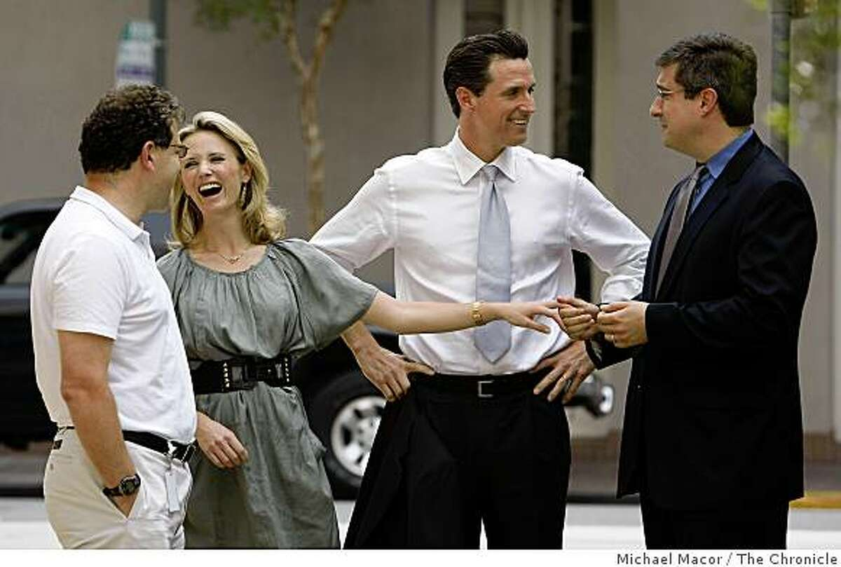 (left to right) Elliott Schrage, Facebook's, vice president of communications and public policy, Jennifer Siebel, mayor Newsom's wife, San Francisco Mayor Gavin Newsom and Chris Kelly, Facebook's, chief privacy officer,head of public policy, tour the company headquarters of Facebook, on Tuesday April 21, 2009 in Palo Alto, Calif., as Newsom officially announced his run for governor of California, on the internet using YouTube, Twitter and Facebook.