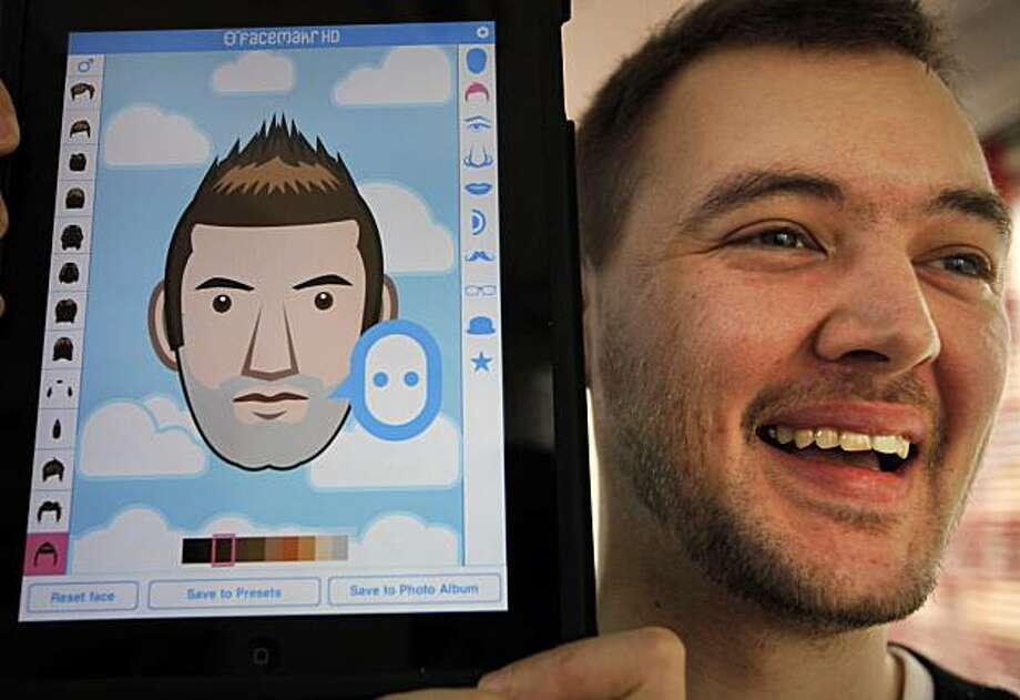"In this Oct. 19, 2010 photo, Dadako Studio Japan President Hawken King, a 32-year-old Briton, shows an avatar application he developed for iPhone users at his office in Tokyo, Japan. His 115 yen ($1.40) ""Facemakr"" allows people to easily and smoothly create avatars, or facial likenesses, on iPhone's touch panel, choosing images of noses, eyes and hairstyles. Photo: Itsuo Inouye, Associated Press"
