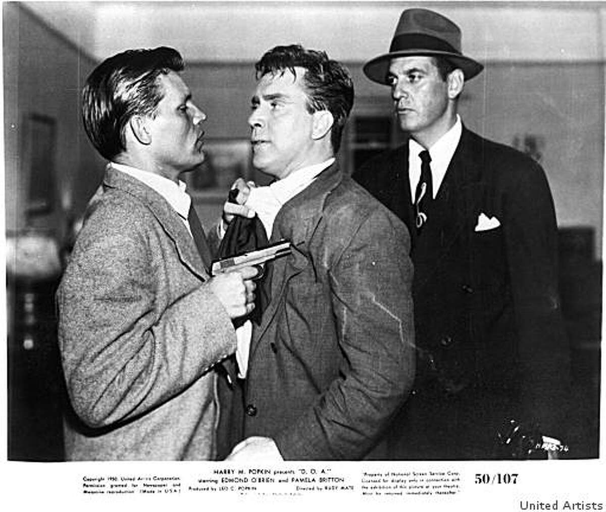 A psychotic gunman (Neville Brand, left) and his accomplice (Michael Ross, right) rough up a dying businessman (Edmond O'Brien) in United Artists' D.O.A. (1950)