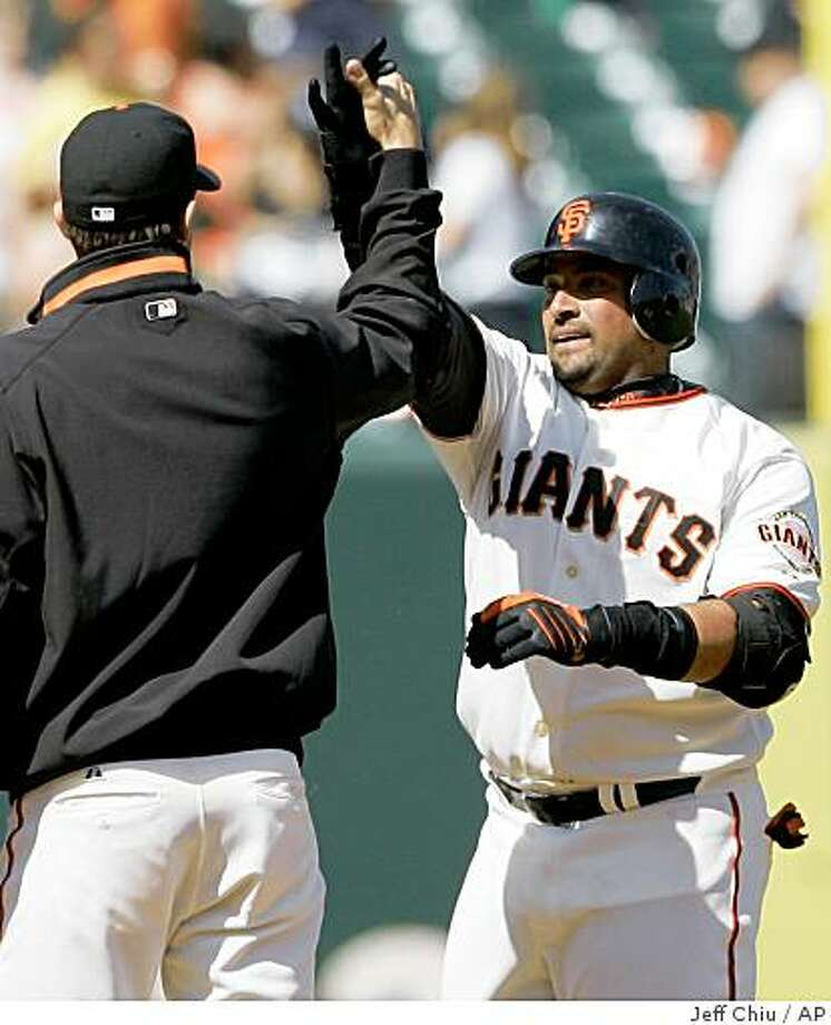San Francisco Giants' Bengie Molina, right, celebrates with Barry Zito after hitting the game-winning pinch-hit RBI double off of San Diego Padres pitcher Edwin Moreno to score Andres Torres in the 10th inning of a game in San Francisco, Wednesday, April 22, 2009. The Giants won 1-0 in 10 innings. Photo: Jeff Chiu, AP
