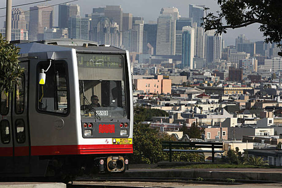 A J line car travels along the tracks at 20th and Church Streets on Friday, November 26, 2010 in San Francisco, Calif. Photo: Lea Suzuki, The Chronicle