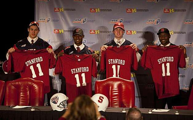 Stanford football recruits, from left to right, Devon Cajuste, Wayne Lyons, Kevin Hogan, and Ty Montgomery pose for photos after signing commitment letters to play football during at a national signing day breakfast on Wednesday, February 2, 2011 in Austin, Texas. The recruits made their announcement before playing a game between the under-19 USA team and World team. Photo: Ben Sklar, Special To The Chronicle