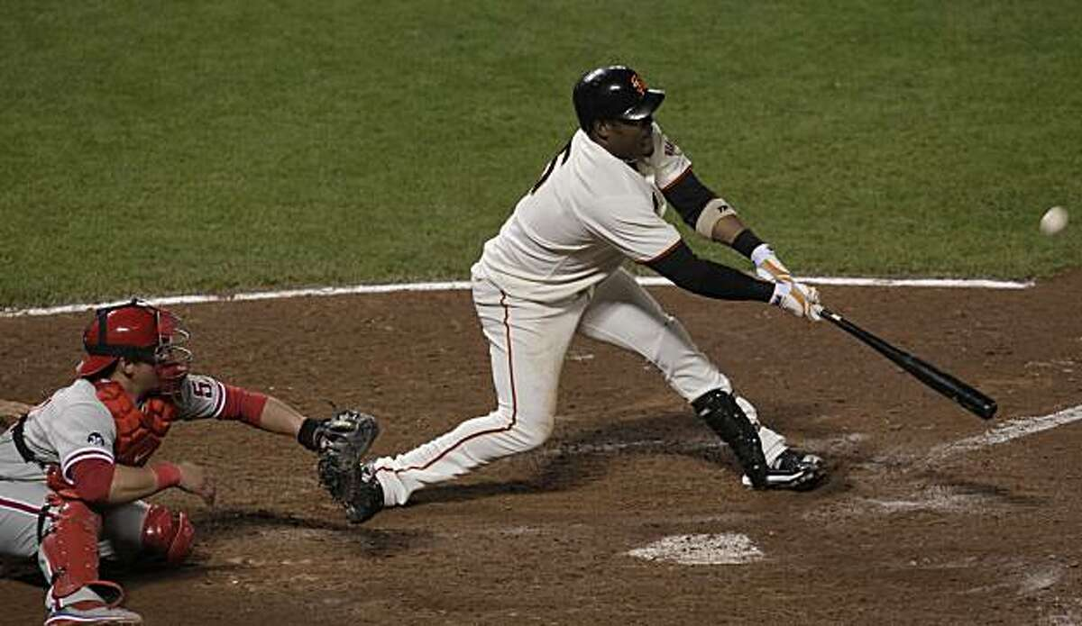 San Francisco Giants Juan Uribe hits the line drive that knocks Aubrey Huff in for the winning run against the Philadelphia Phillies in Game 4 of the National League Championship Series, Wednesday, Oct. 20, 2010, at AT&T Park in San Francisco, Calif.