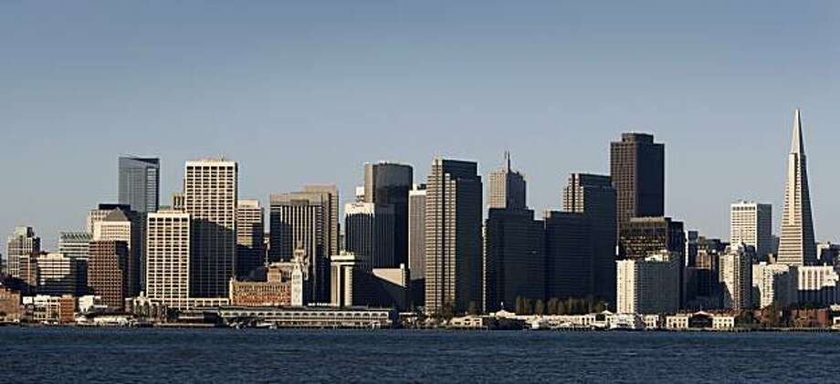 The downtown skyline is bathed in morning sunlight  in San Francisco, Calif., on Tuesday, April 14, 2009 where many small commercial buildings are behind on payments to lenders and could face foreclosure. Photo: Paul Chinn, The Chronicle