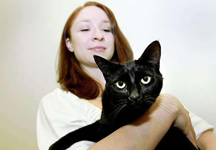 "Bella loves to have her picture taken, especially with Stephanie. Bella the cat has a part in the new play ""The Lieutenant of Inishmore"" opening at the Berkeley Rep. Bella, who lives in Houston, Texas, is owned by Stephanie Alt. Photo: Brant Ward, The Chronicle"