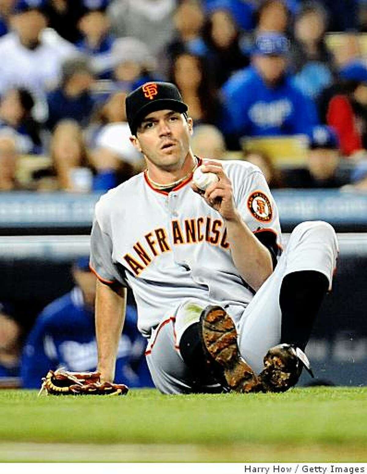 LOS ANGELES, CA - APRIL 16: Barry Zito #75 of the San Francisco Giants fields a foul ground ball against the Los Angeles Dodgers during the second inning at Dodger Stadium on April 16, 2009 in Los Angeles, California. (Photo by Harry How/Getty Images)