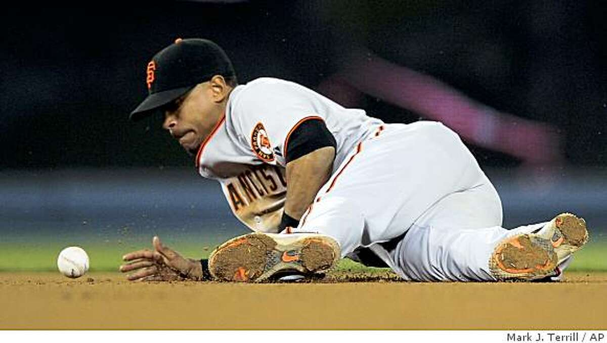 San Francisco Giants shortstop Emmanuel Burriss can't hold on to a ball hit for a base hit by Los Angeles Dodgers' Orlando Hudson during the eighth inning of a baseball game, Thursday, April 16, 2009, in Los Angeles. (AP Photo/Mark J. Terrill)