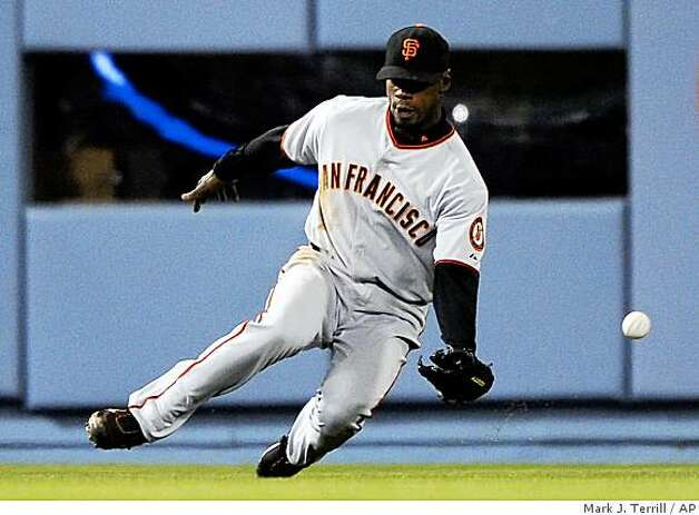 San Francisco Giants left fielder Fred Lewis misses a ball hit for a triple by Los Angeles Dodgers' Matt Kemp during the second inning of a game, Thursday, April 16, 2009, in Los Angeles. Photo: Mark J. Terrill, AP
