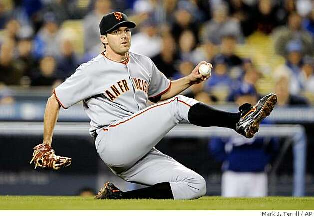 San Francisco Giants starting pitcher Barry Zito tries, but gives up on throwing Los Angeles Dodgers' Casey Blake out at first after catching a bunt by Eric Stults during the second inning of a game, Thursday, April 16, 2009, in Los Angeles. Photo: Mark J. Terrill, AP