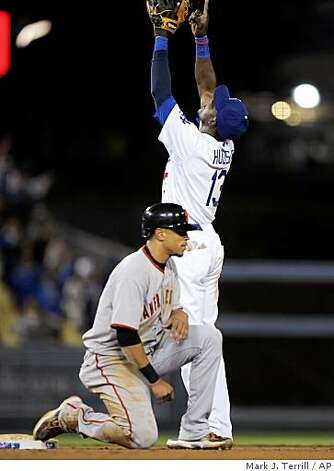 Los Angeles Dodgers second baseman Orlando Hudson points toward the sky as San Francisco Giants' Emmanuel Burriss looks on after Burriss was involved in a game-ending double, Thursday, April 16, 2009, in Los Angeles. The Dodgers won 7-2. Photo: Mark J. Terrill, AP