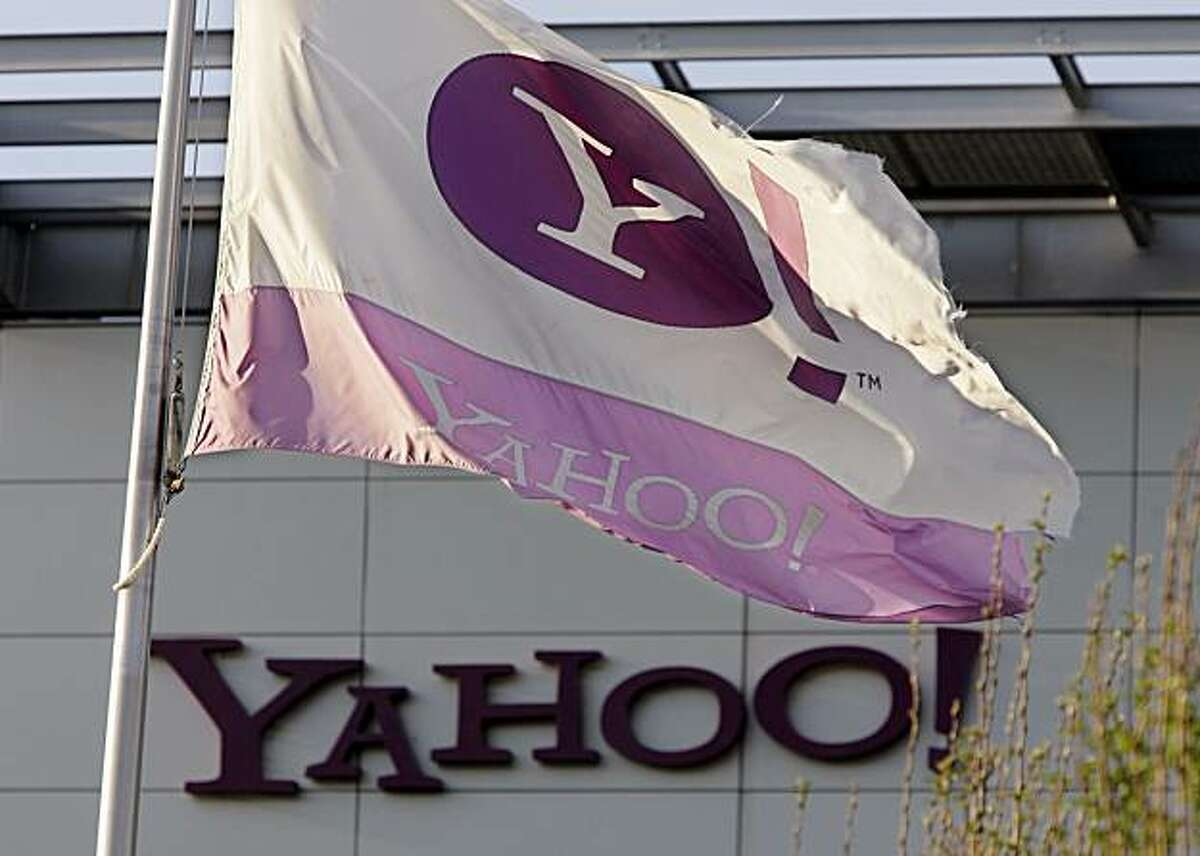 The Yahoo flag flies at Yahoo headquarters in Sunnyvale, Calif., Monday, April 20, 2009. Yahoo Inc. confirmed Tuesday that it would cut 675 jobs, or 5 percent of its workforce. Yahoo's first-quarter profit fell 78 percent to $118 million. (AP Phoito/Paul Sakuma)