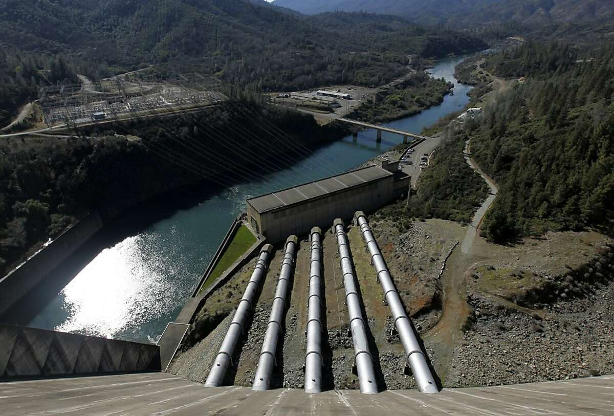 Water captured in Lake Shasta flows through five penstocks to the hydroelectric power plant at the base of Shasta Dam in Shasta Lake City, Calif. on Wednesday, Feb. 7, 2012. The Bureau of Reclamation has just released a draft feasibility report which outlines plans to raise the height of the dam 18.5 feet to increase the water capacity of Lake Shasta.