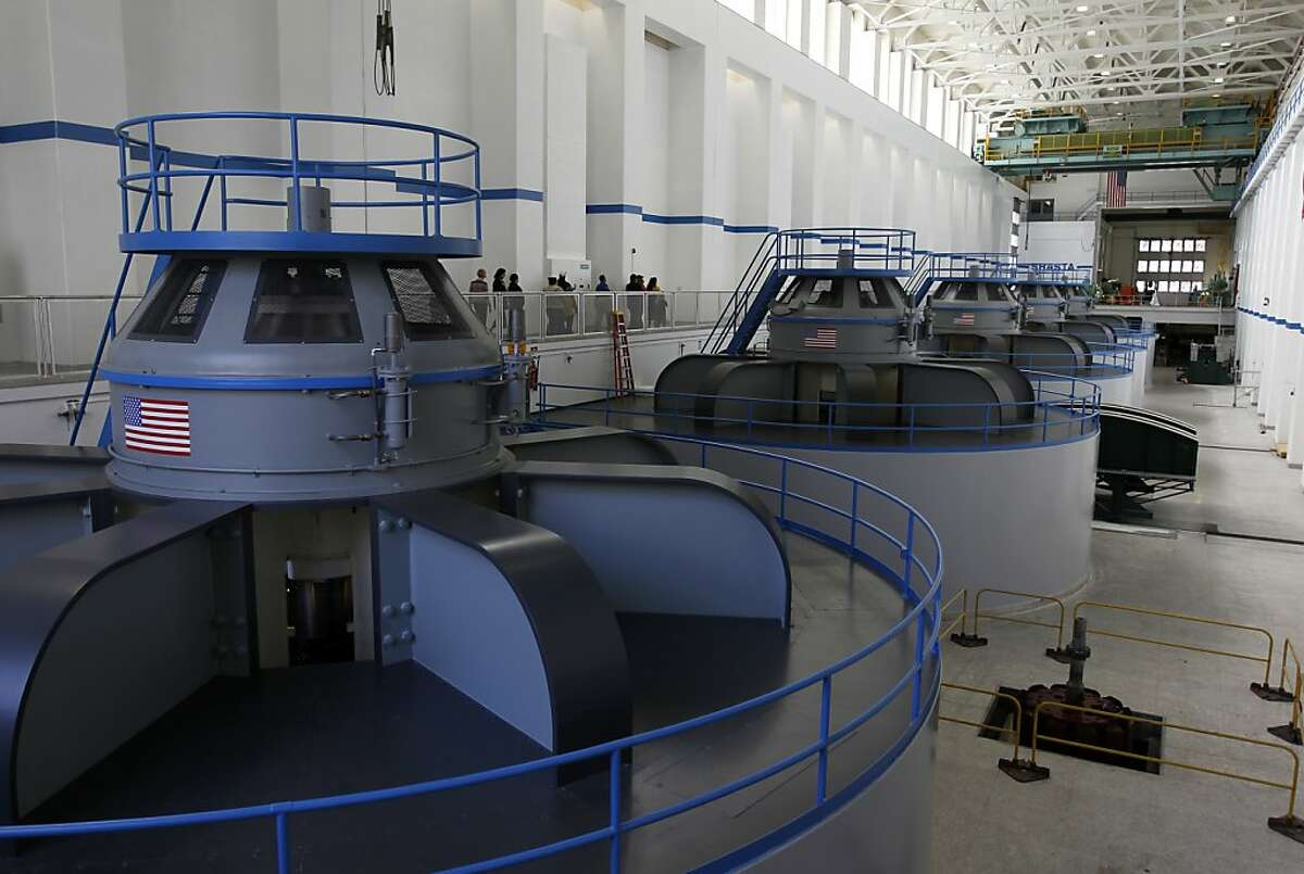 Visitors tour the hydroelectric power plant at the base of Shasta Dam in Shasta Lake City, Calif. on Wednesday, Feb. 8, 2012. The Bureau of Reclamation has just released a draft feasibility report which outlines plans to raise the height of the dam 18.5 feet to increase the water capacity of Lake Shasta.