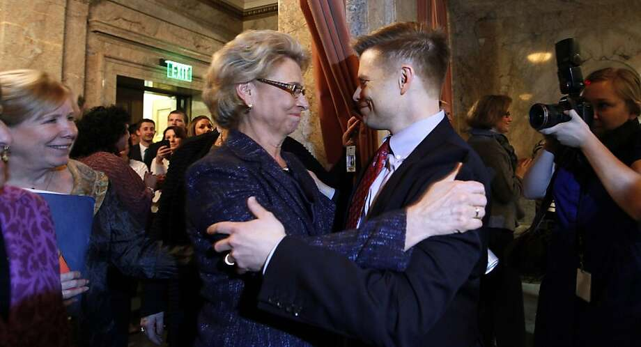Gov. Chris Gregoire, left, is embraced by Rep. Jamie Pedersen, D-Seattle, after the House voted to legalize gay marriage in Washington state Wednesday, Feb. 8, 2012, in Olympia, Wash. The action comes a day after a federal appeals court declared California's ban on same-sex marriage unconstitutional, saying it was a violation of the civil rights of gay and lesbian couples. Gregoire is likely to sign the bill next week. Photo: Elaine Thompson, Associated Press