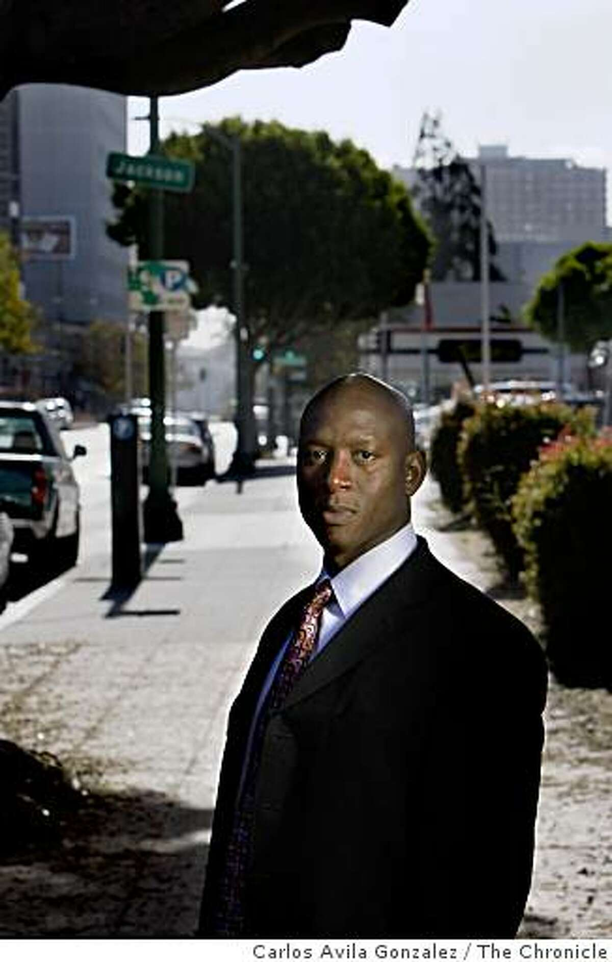 Oakland Police Detective Derwin Longmire stands near the spot on September 18, 2007, where Chauncey Bailey, the editor of the Oakland Post was killed, in Oakland, Calif.
