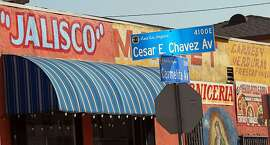 Signs in Spanish and English, and the Virgin of Guadalupe, the patron saint of Mexico, are seen at the Jalisco Market on Cesar E. Chavez Avenue in East Los Angeles, an area of unincorporated Los Angeles County territory east of downtown Los Angeles, Wednesday, Feb. 8, 2012. The Local Agency Formation Commission (LAFCO) voted Wednesday not to grant cityhood to East L.A., which has some 130,000 people - 96 percent of them Latino - packed into 7.4 square miles. Cityhood proponents complain that East L.A. is treated as an afterthought by the county Board of Supervisors, and they want the community to take charge of its own destiny. (AP Photo/Reed Saxon)