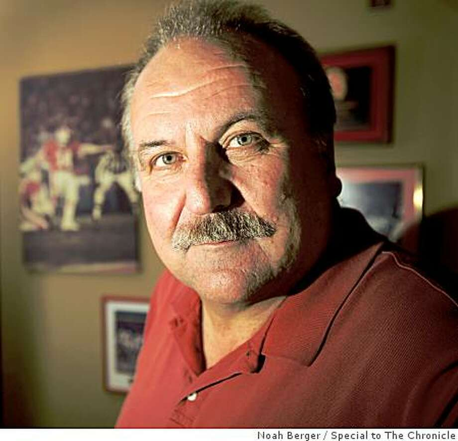 Former 49er Ray Wersching stands with photos from his football career at his San Carlos, Calif., home on Wednesday, Feb. 11, 2009. Photo: Noah Berger, Special To The Chronicle