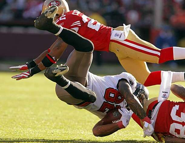 San Francisco's Nate Clements upends Tampa Bay's Kellen Winslow after Winslow was hit by Dashon Goldson in the third quarter at Candlestick Park in San Francisco on Sunday. Photo: Carlos Avila Gonzalez, The Chronicle
