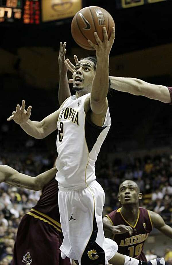 California guard Jorge Gutierrez (2) scores against Arizona State during the second half of an NCAA college basketball game in Berkeley, Calif., Thursday, Feb. 3, 2011. California won 66-62. Photo: Marcio Jose Sanchez, AP