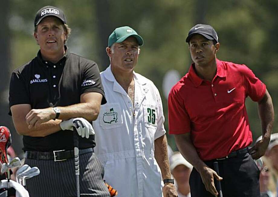 From left, Phil Mickelson, caddie Steve Williams and Tiger Woods wait on the first tee during the final round of the Masters golf tournament at the Augusta National Golf Club in Augusta, Ga., Sunday, April 12, 2009. (AP Photo/Morry Gash) Photo: Morry Gash, AP