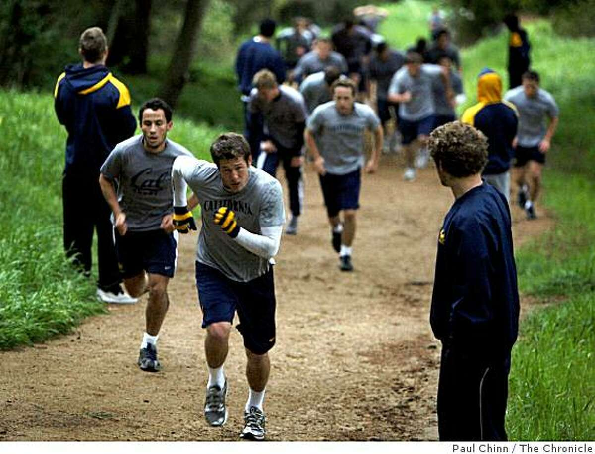 Members of the Cal Bears rugby team runs straight up a steep fire trail above the campus as part of its annual April Drive training period in Berkeley, Calif., on Wednesday, April 8, 2009.