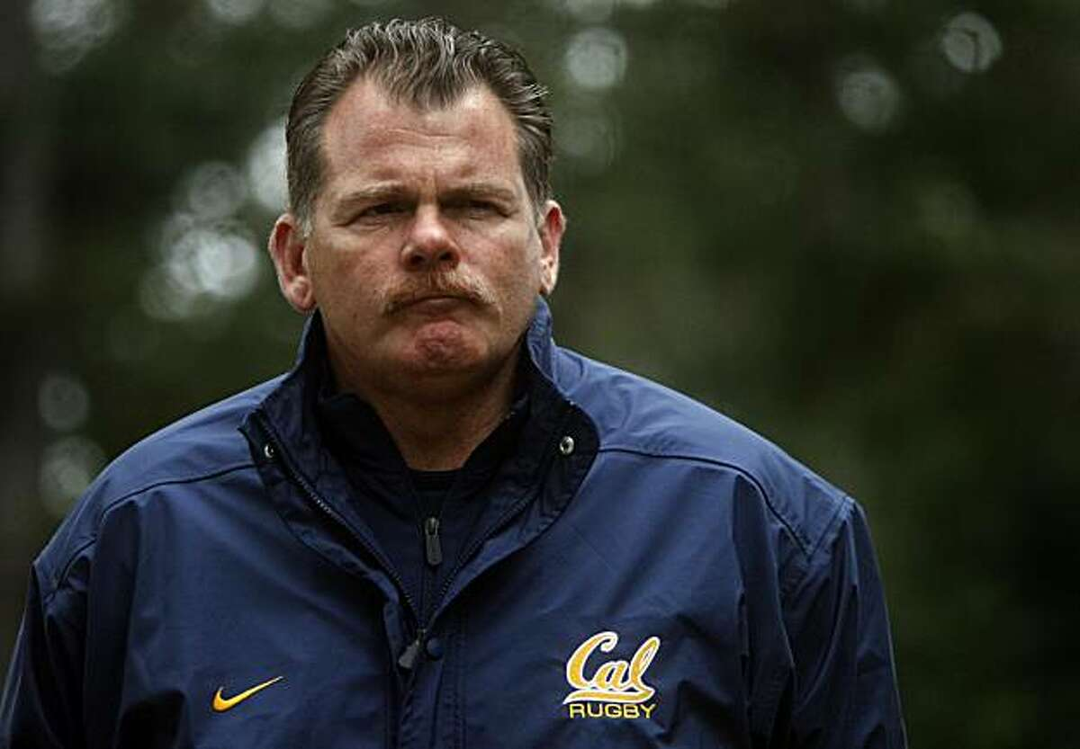 Head coach Jack Clark watches his Cal Bears rugby players run to the top of a steep fire trail as part of the team's annual April Drive training period in Berkeley, Calif., on Wednesday, April 8, 2009.