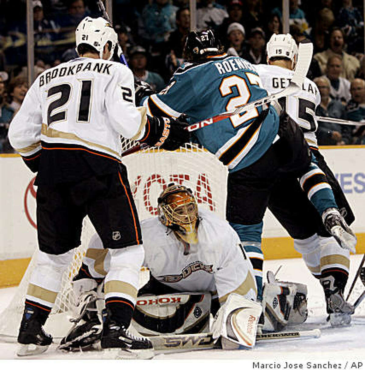 Anaheim Ducks goalie Jonas Hiller, bottom center, stops a shot attempt from San Jose Sharks center Jeremy Roenick, second from right, as Sheldon Brookbank, left, and Ryan Getzlaf defend during the second period of Game 1.