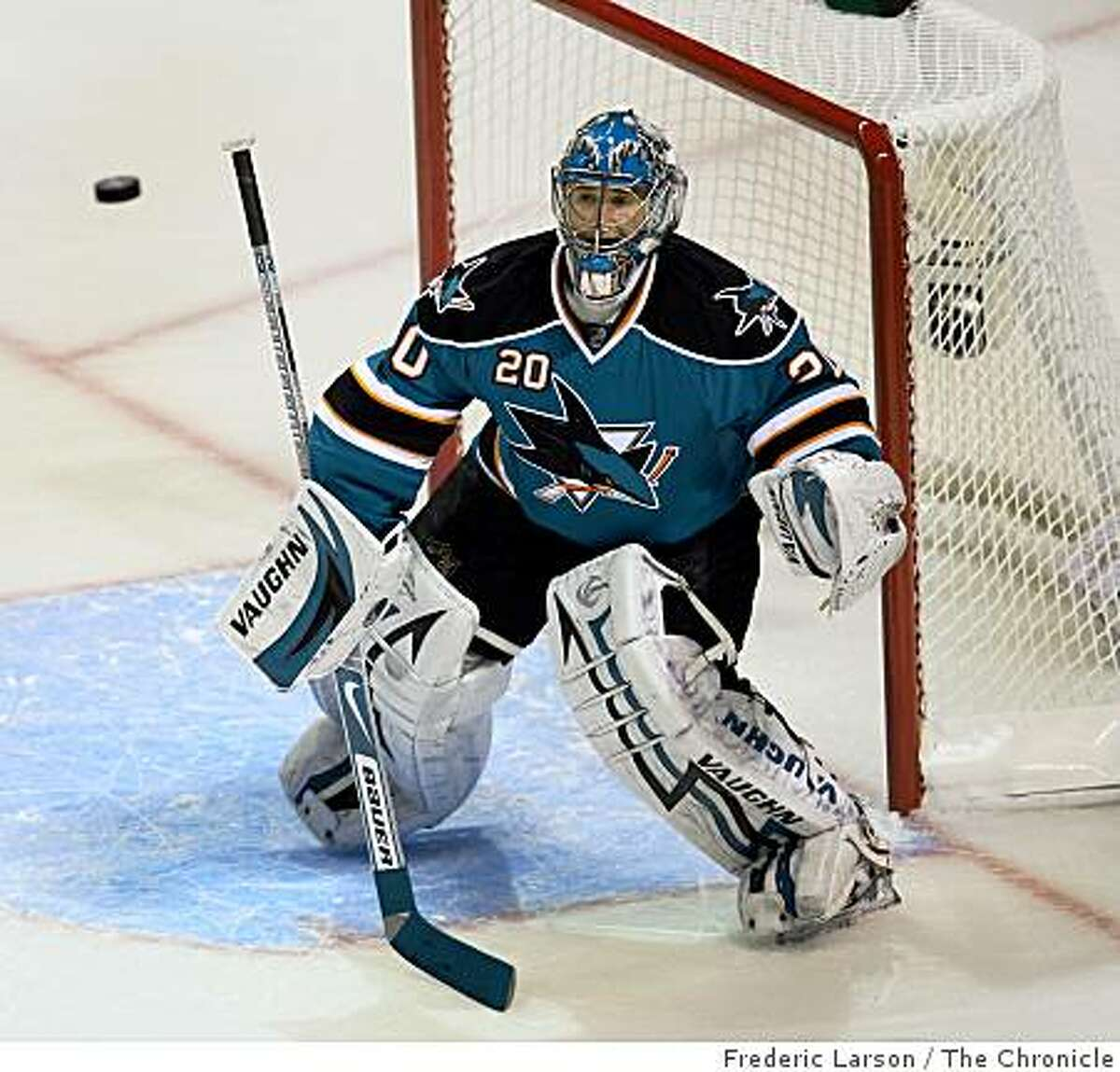 San Jose Sharks goalie Evgeni Nabokov defends a high shot on goal in the first period against the Anaheim Duck in the first round of the Stanley Cup Playoffs in San Jose on April 16, 2009.