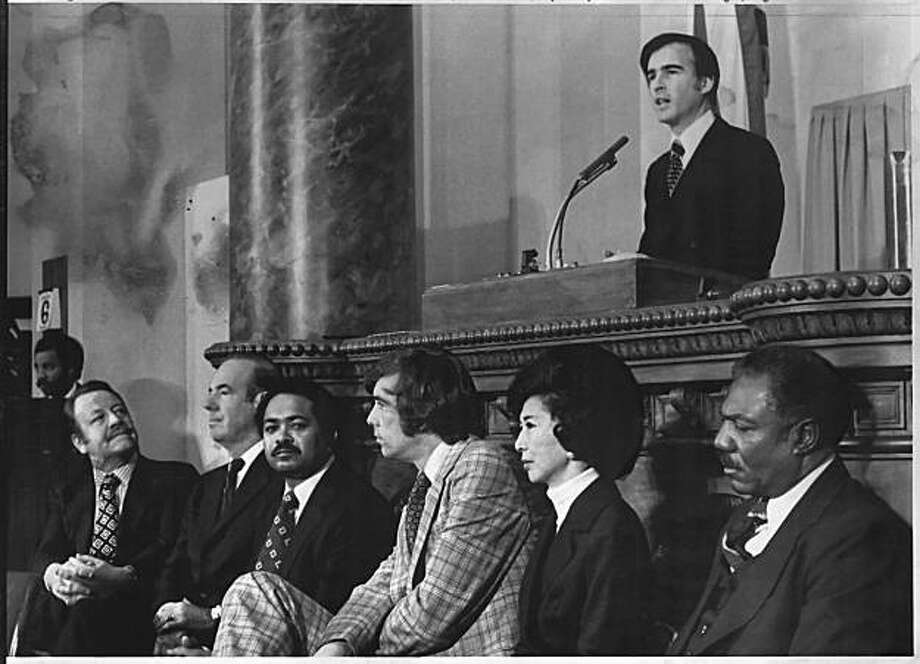 Gov. Jerry Brown delivers his inaugural address after taking the oath of office in the Assembly Chamber January 6, 1975 in Sacramento, Calif.  Listening are the new constitutional officers, (L-R) Treasurer Jess Unruh, Attorney General Evelle Younger, Lt. Gov. Mervyn Dymally, Controller Kenneth Cory, Secretary of State March Fong Eu, and Superintendent of Public Instruction Wilson Riles. Photo: Upi, UPI