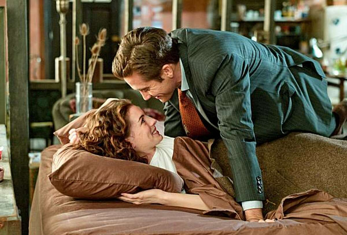 """In this publicity image released by 20th Century Fox, Jake Gyllenhaal, right, and Anne Hathaway are shown in a scene from """"Love and Other Drugs."""""""