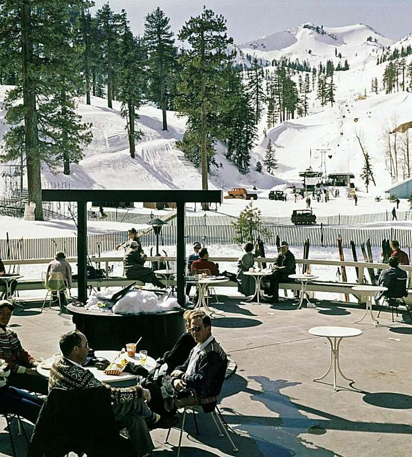 FILE - This Feb. 1, 1960 file photo shows the Squaw Valley ski resort in California during the 1960 Winter Olympics.  Owners of the Lake Tahoe-area ski resort have agreed to sell Squaw Valley USA to a Colorado-based investment firm that's pledging $50 million in improvements over the next five years, company officials said Tuesday. Photo: AP
