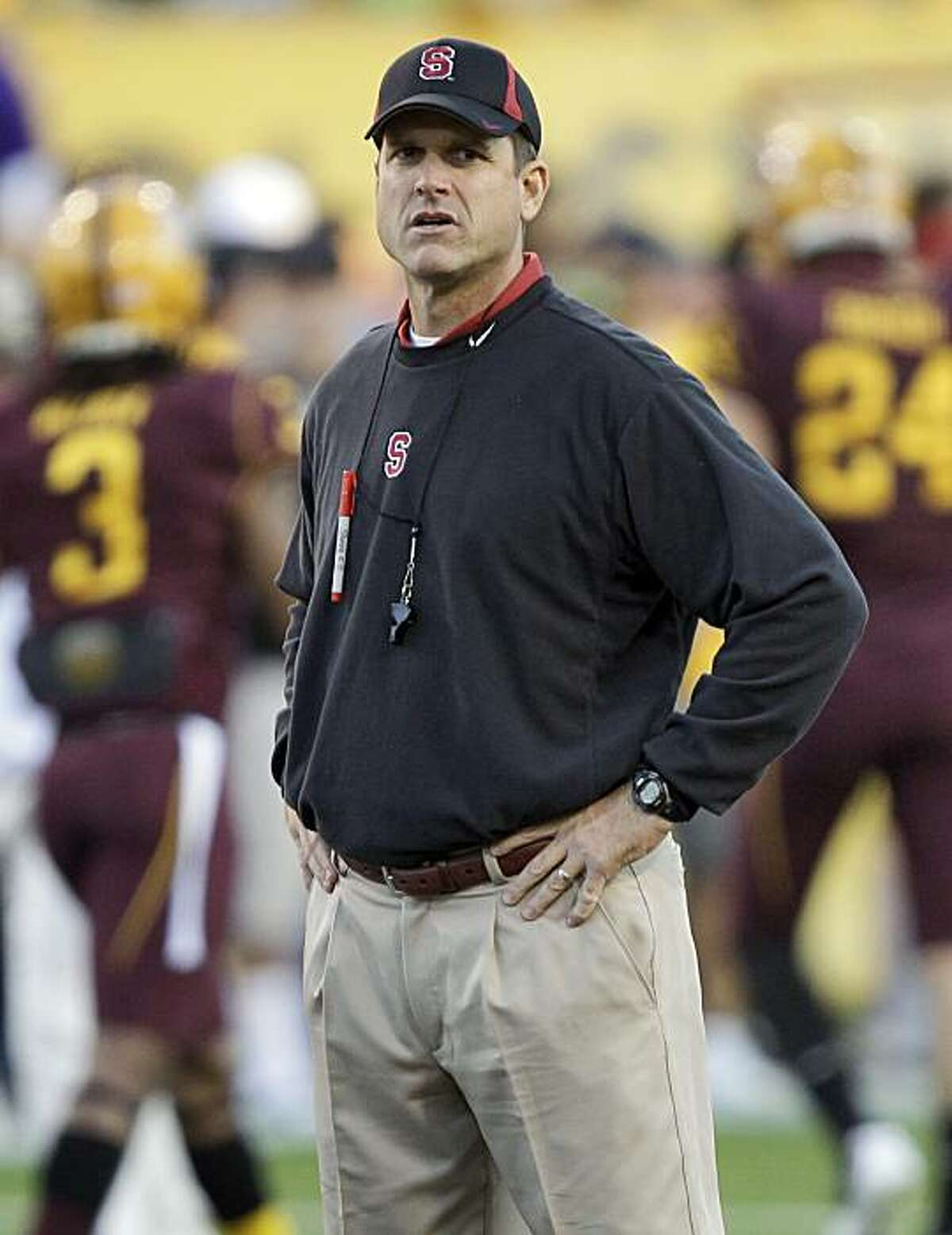 Stanford head coach Jim Harbaugh watches his team warm up prior to an NCAA football game against Arizona State Saturday, Nov. 13, 2010, in Tempe, Ariz.