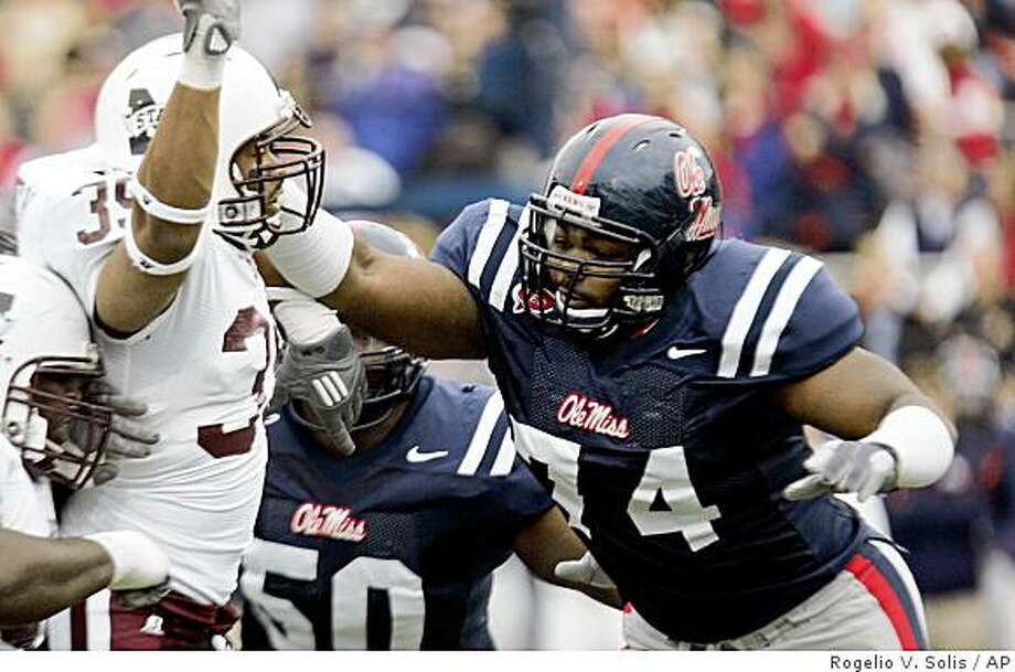 FILE - In this Nov. 28, 2008 file photo, Mississippi State defensive end Tim Bailey (39) is shoved back by Mississippi offensive lineman Michael Oher (74) in the first half of an NCAA college football game in Oxford, Miss. (AP Photo/Rogelio V. Solis, File) Photo: Rogelio V. Solis, AP