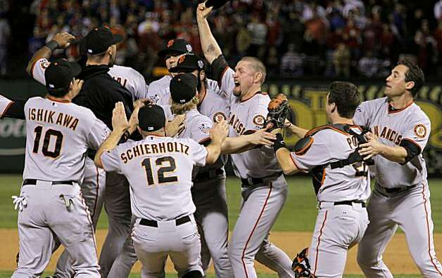 Aubrey Huff , (center) celebrates with the team as the San Francisco Giants take game 5 to win the  2010 World Series over the Texas Rangers on Monday Nov. 1, 2010 in Arlington, Tx., with a score of 3-1. Photo: Michael Macor, San Francisco Chronicle