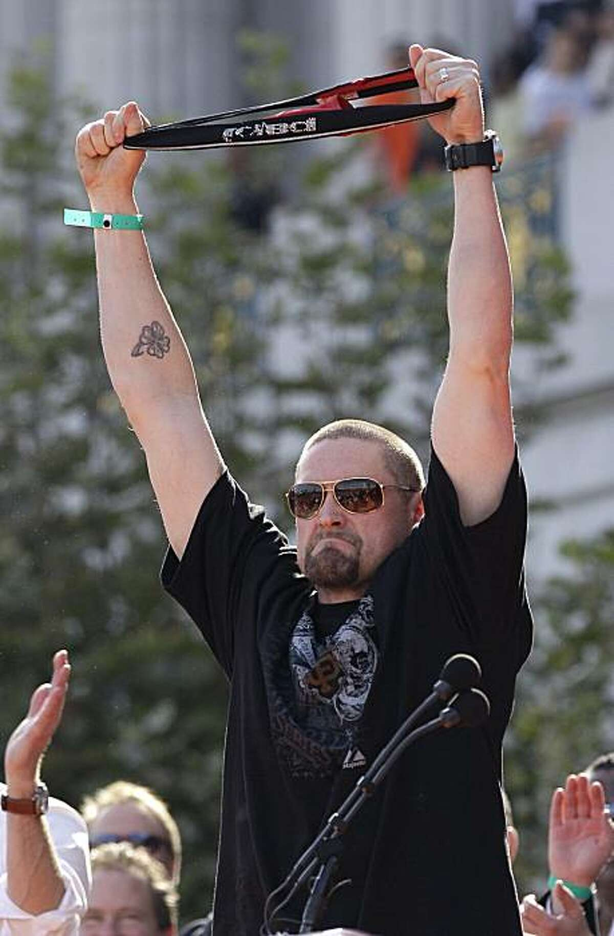 San Franicisco Giants baseball player Aubrey Huff holds up his lucky red rally thong he wore this season during the Giants' World Series victory celebration at Civic Center Plaza in San Francisco, Wednesday, Nov. 3, 2010.