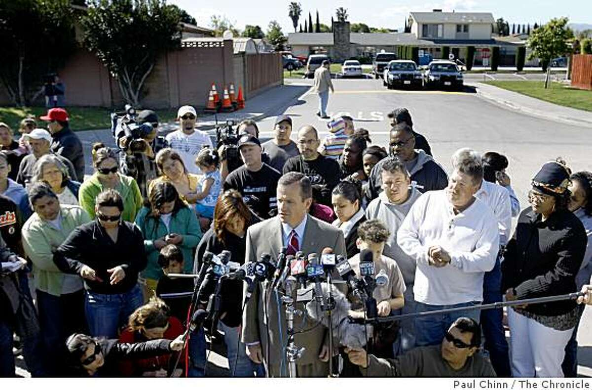 Police Sgt. Tony Sheneman (center) provides details on the arrest of Melissa Huckaby for the murder of eight-year-old Sandra Cantu at a news conference across the street from the Orchard estates mobile home park (background) in Tracy, Calif., on Saturday, April 11, 2009.