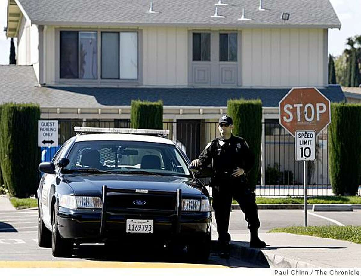 A police officer continues to guard the entrance to the Orchard Estates mobile home park after investigators announced the arrest of Melissa Huckaby for the murder of eight-year-old Sandra Cantu in Tracy, Calif., on Saturday, April 11, 2009.