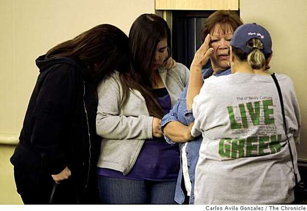Volunteers in the search for Sandra Cantu, react to the news that Cantu had been found in a sealed suitcase earlier in the day. Tracy authorities revealed during a press conference at Tracy City Hall in Tracy Calif., that the contents found in an irrigation pond two miles from the home of Sandra Cantu on Monday, April 6, 2009 were indeed the remains of the eight-year-old Tracy girl. Cantu had been missing since March 27, 2009. Photo: Carlos Avila Gonzalez, The Chronicle